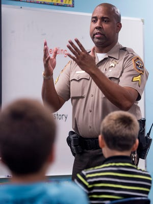Cpl. Kofee Anderson of the Montgomery County Sheriff's Department teaches a DARE class to fifth grade pupils at Hooper Academy in Hope Hull, Ala. on Wednesday October 18, 2017. Anderson has been named the National DARE officer of the year.