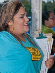 """Cecilia Pinon, a canvaser with Strong Families New Mexico, listens to one of many speakers at the  """"We Decide"""" celebration honoring of abortion providers held at the Whole Women's Health clinic on Lohman Ave. 9/29/16"""