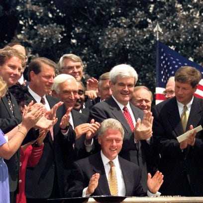 President  Clinton and House Speaker Newt Gingrich (in red tie).