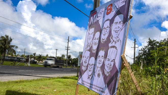 A sign erected by the Guamanians for Fair Government group could be seen along Marine Corps Drive in Dededo on Tuesday, Oct. 25.