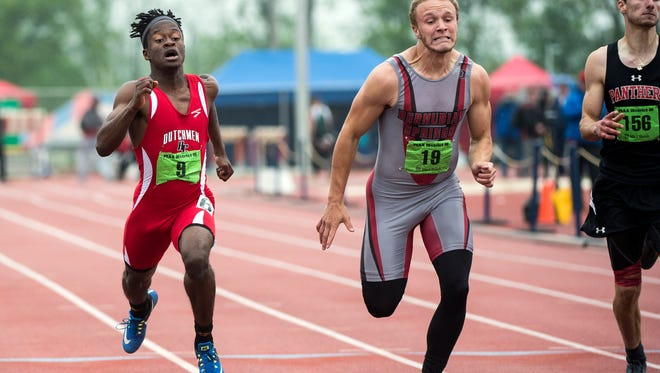 Annville-Cleona's Stanley Miller, left, takes first place in a tight finish against Bermudian Springs' Ryan Curfman, center, and Schuylkill Valley's Luke Williams in the 200-meter dash at the District III track and field championships held at Shipppensburg University, Saturday, May 19, 2018.