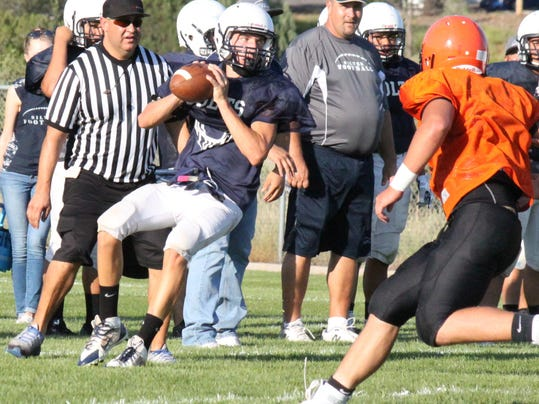 Silver quarterback Chad Fowler did an excellent job of moving the football and scoring a touchdown on the opening drive of Wednesday night's scrimmage against Lordsburg.