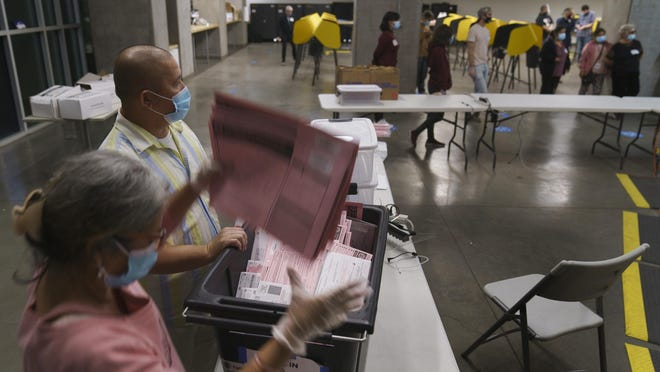 Los Angeles County Registrar-Recorder/County Clerk workers tally provisional ballots as their polling place closes at the Los Angeles City College in Los Angeles, on Tuesday, Nov. 3. With Michigan voters having cast their ballots Tuesday, the focus now turns to whether election results might be contested in the state or elsewhere in the nation.