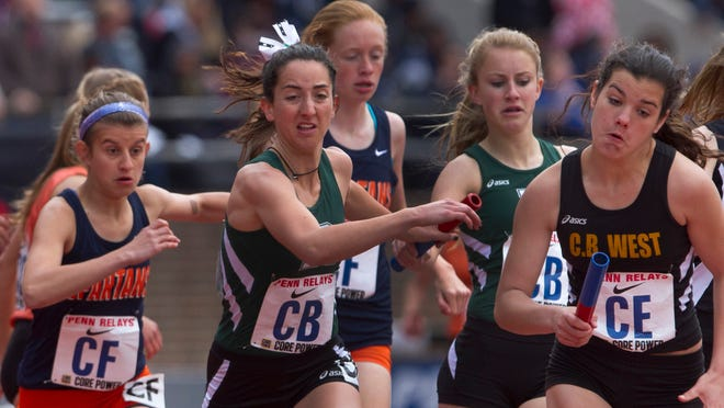 Ridge's Emily Hirsch hands off to anchor Abby Regner during Girls 4x800 trials. They qualified for Friday's final. Thursday at Penn Relays in Philadelphia.