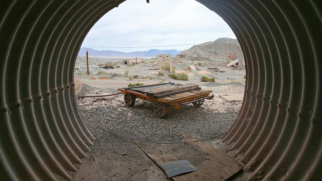 A tunnel frames a rail car from a bygone era at the former Eagle Mountain iron mine on Nov. 14, 2014.