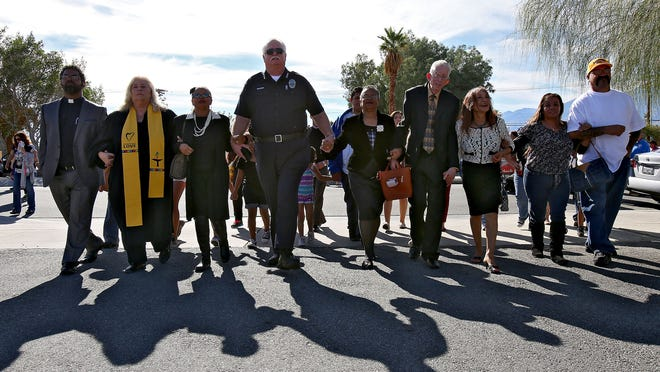 """Community leaders walk in the first """"Unity and Peace"""" Walk in honor of Dr. Martin Luther King at the Desert Hot Spring Police Department on Monday, January 19, 2015."""