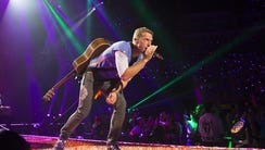 Chris Martin performs with Coldplay at Gila River Arena