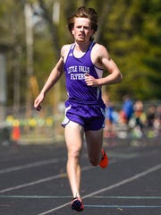 Little Falls' Tyler Moore crosses the finish line to win the 3200 run during the Sauk Rapids Mega Meet Saturday, May 6, in Sauk Rapids.