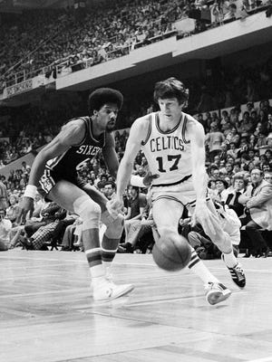 FILE - In this April 29, 1977 file photo, Boston Celtics' John Havlicek (17) moves the ball past Philadelphia 76ers' Julius Erving during Game 6 of the NBA Eastern Conference semifinals at Boston Garden. The Celtics won, 113-108, but the Sixers prevailed in Game 7, 83-77, to advance. Philadelphia eventually lost to Portland in the NBA Finals. Associated Press