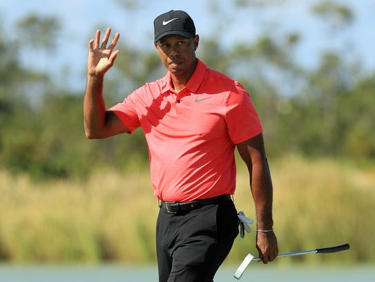 Tiger Woods reacts on the fourth green during the final