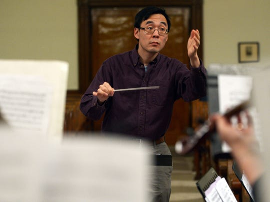 Dr. Paul Kim conducts the Orchestra of the Eastern Shore. The orchestra hired Kim, a music professor at Old Dominion University in Norfolk, as musical director last fall.