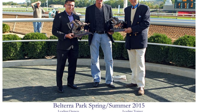 Louisville auto dealer Billy Hays (center) accepting his latest of many trophies as leading owner at Belterra Park, the track formerly known as River Downs.
