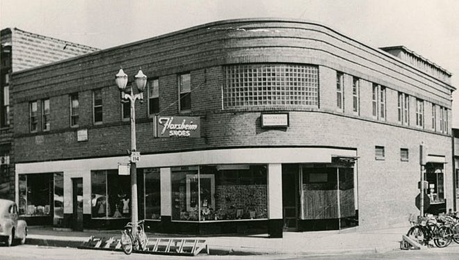 Tuchscherer's Shoe Store, built in 1940 in Menasha. On the first floor was the shoe store, Patzel Dress Shop, Madeleine's Gift Shop and Coppens Shoe. The second floor housed attorney M.F. Crooley, Dr. R.J. O'Keefe, and R.E. Fahrbach Insurance.