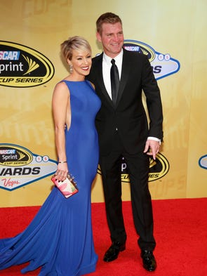 Clint Bowyer and his wife, Lorra, pose on the red carpet