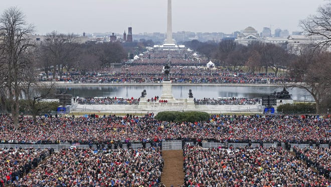 epa05735710 Crowds on the National Mall as President-elect Donald J. Trump  takes the oath of office as the 45th President of the United States in Washington, DC, USA, 20 January 2017. Trump won the 08 November 2016 election to become the next US President.  EPA/SHAWN THEW