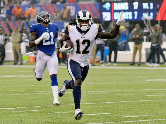 Los Angeles Rams' Sammy Watkins (12) runs from New York Giants' Landon Collins (21) for a touchdown during the first half of an NFL football game Sunday, Nov. 5, 2017, in East Rutherford, N.J. (AP Photo/Bill Kostroun)