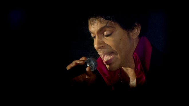 Prince performs at the SXSW Music Festival in Austin, Texas, in 2013. The musician died in his home recording studio in Chanhassen, Minn., on Thursday, April 21, 2016. He was 57. (Jay Janner/Austin American-Statesman/TNS)