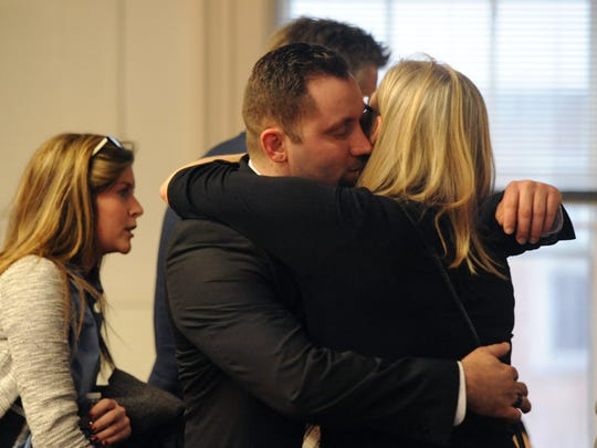 Joel Jenkins hugs family and friends after the jury reached a not guilty verdict Tuesday, Jan. 17, 2017, in Pike County Common Pleas Court.