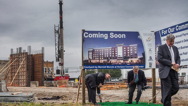 Attendees of the groundbreaking ceremony for The Arc of Indiana Courtyard by Marriott hotel in the Horizon Convention Center tour the construction site after the event.