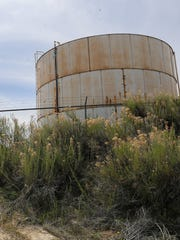 Water storage tanks are pictured Monday in the Harvest Gold Subdivsion.