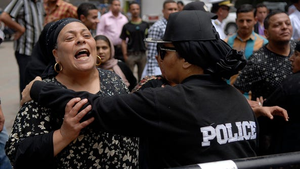A police woman hold a pro-government protestor while