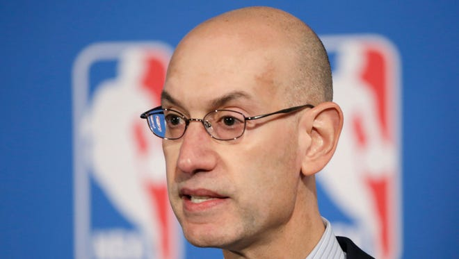 NBA Commissioner Adam Silver answers questions at a news conference after a deal was announced between the league and TV networks, Monday, Oct. 6, 2014 in New York. The NBA has extended its television deals with ESPN and TNT for nine years. The league announced Monday that the new contracts will run through the 2024-25 season. The previous eight-year agreements end after the 2015-16 season.