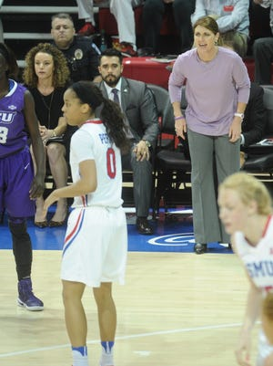 ACU coach Julie Goodenough, back right, coaches her team during its game against SMU on Monday, March 20, 2017 in a second-round WNIT game in Dallas. SMU won the game 59-52.