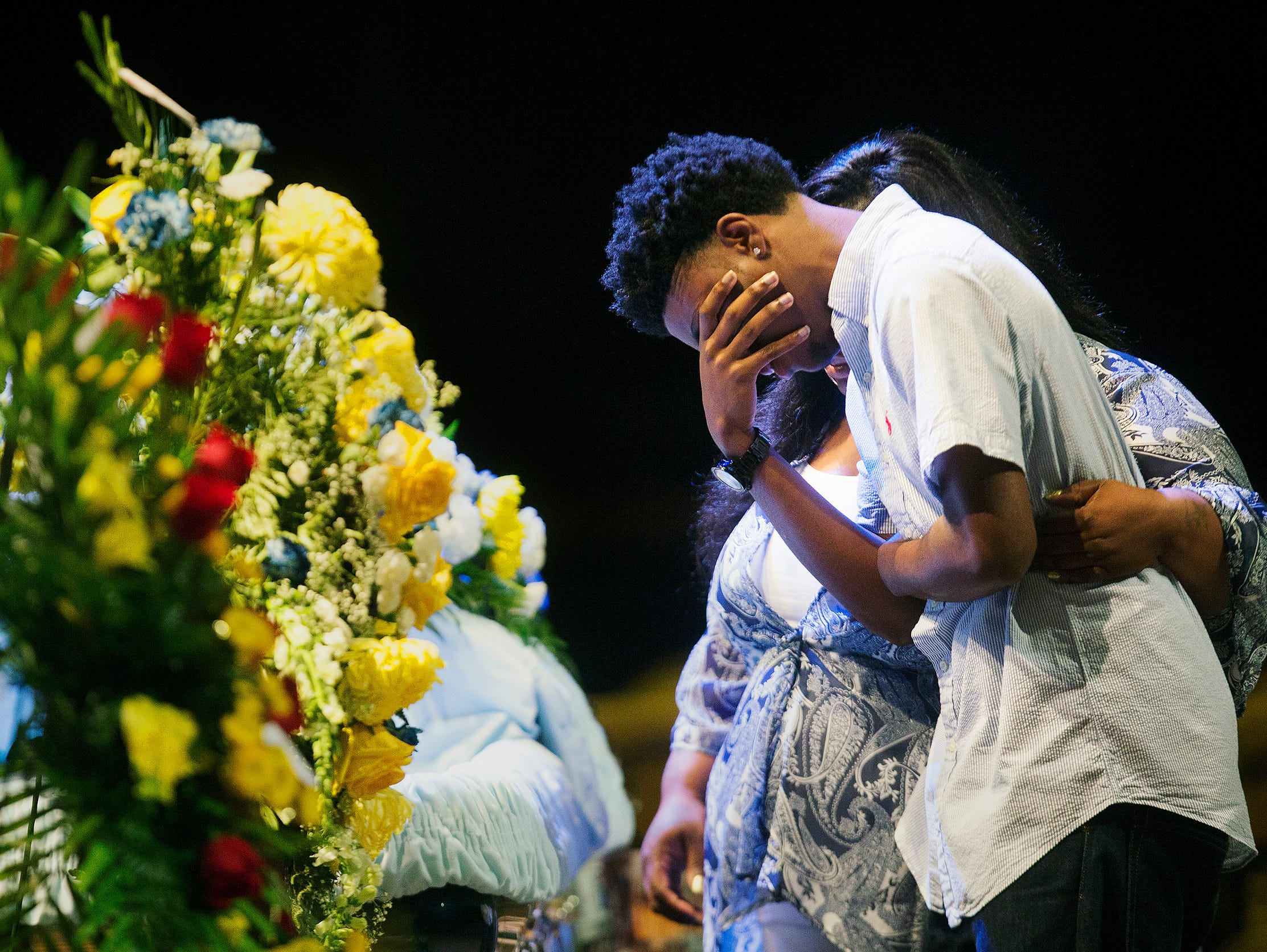 """Anthony Sibert, 17, weeps at Stef'An Strawder's casket Saturday during Strawder's funeral at New Life Assembly of God in Lehigh Acres. Strawder was killed recently in the Club Blu nightclub shooting in Fort Myers. """"Memories,"""" of playing basketball with Strawder are what Sibert said he would cherish most."""