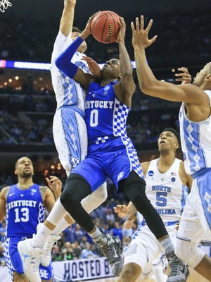 Kentucky's De'Aaron Fox couldn't score past UNC's Justin Jackson late in the second half as the Tarheels outlasted the Wildcats 75-73 Sunday at the Elite Eight game in Memphis.