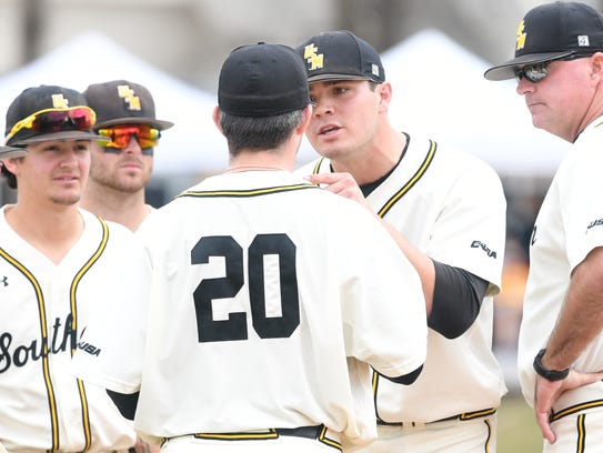 Southern Miss starting pitcher Stevie Powers, right,