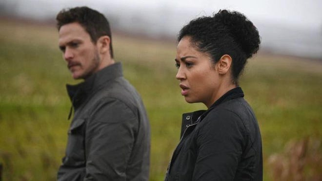 """Jonathan Tucker and Riann Steele in new sci-fi series """"Debris,"""" which debuts at 10 p.m. Monday on NBC."""