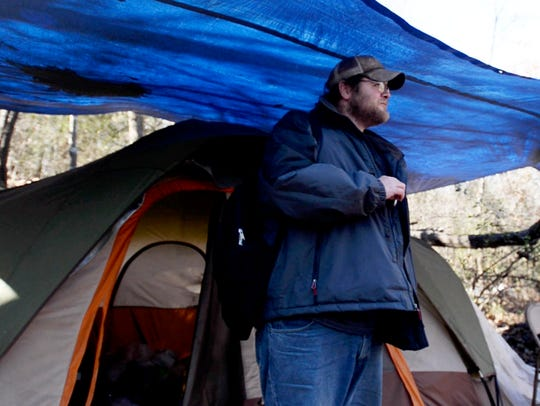 Nick Kennedy near his tent in the woods in downtown