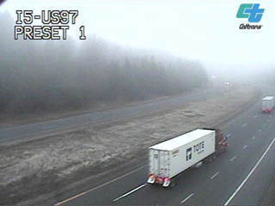A Caltrans webcam along Interstate 5 near Weed shows a light dusting of snow on the ground as of Tuesday afternoon.