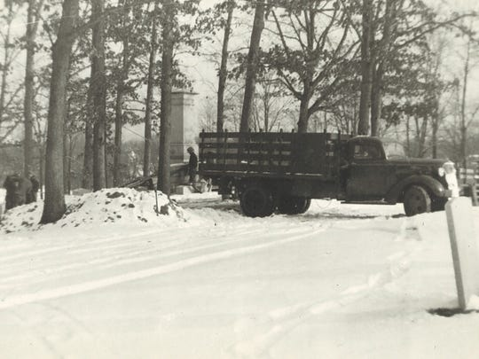 A truck is seen in Woodlawn Cemetery in Elmira after the Mark Twain monument was unloaded during the winter of 1937.