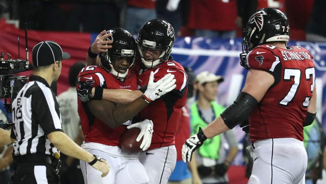 Jan 14, 2017; Atlanta, GA, USA; Atlanta Falcons wide receiver Mohamed Sanu (12) celebrates with quarterback Matt Ryan (2) after a touchdown against the Seattle Seahawks during the fourth quarter in the NFC Divisional playoff at Georgia Dome.