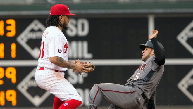 Jun 16, 2017; Philadelphia, PA, USA; Philadelphia Phillies shortstop Freddy Galvis (13) tags out Arizona Diamondbacks right fielder Gregor Blanco (5) before throwing for a double play during the first inning at Citizens Bank Park. Mandatory Credit: Bill Streicher-USA TODAY Sports