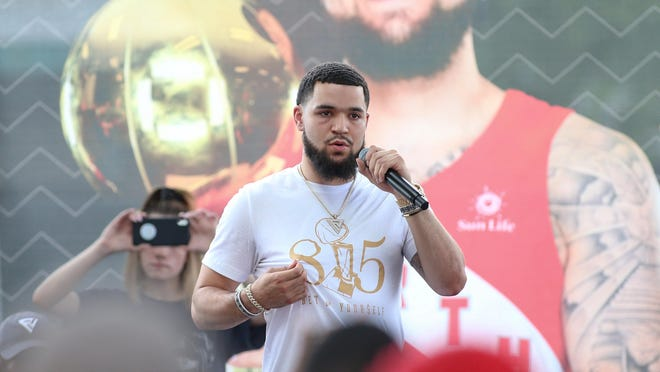 Toronto Raptors guard and NBA champion Fred VanVleet, a Rockford native, speaks to a crowd of thousands during the Fred Comes Home celebration on Saturday, June 29, 2019, at the Rockford City Market pavilion in Rockford.