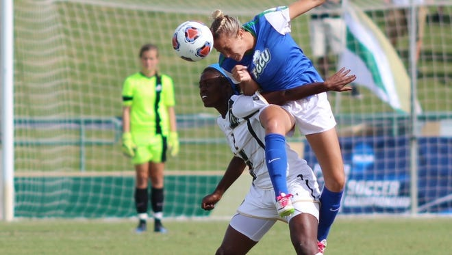 FGCU defender Shea Rhoney vaults USF forward Leticia Skeete during FGCU's 2-1 NCAA tournament first round win Saturday, Nov. 14 at USF's Corbett Stadium in Tampa.