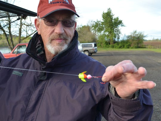 Pat Mcdermott of Keizer shows off the business end of his spring Chinook rig, a Spin-n-Glo and a hook waiting to be baited with a pink-dyed prawn.