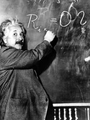 Albert Einstein writes out an equation for the density