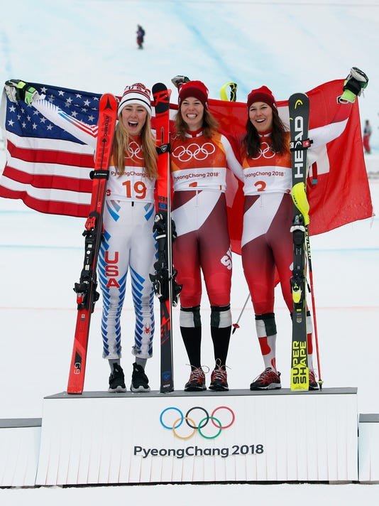 United States' Mikaela Shiffrin, silver, Switzerland's Michelle Gisin, gold, and Switzerland's Wendy Holdener, bronze, from left, pose during the flower ceremony after the women's combined at the 2018 Winter Olympics in Jeongseon, South Korea, Thursday, Feb. 22, 2018. (AP Photo/Christophe Ena)