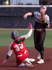 Aggies Kelsey Horton throws to first after forcing out Lobos Jasmine Casados at second base Wednesday evening at the NMSU Softball Complex.