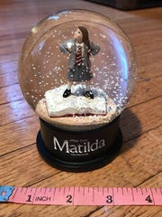"""A """"Matilda"""" snowglobe cast gift is up for auction on eBay to benefit hurricane victims in Puerto Rico."""