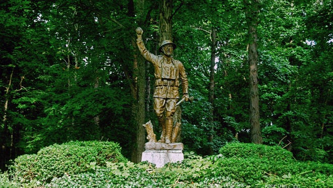 The Spirit of the American Doughboy statue is shown standing guard over New Castle on the hill in Memorial Park in this photo from 2009. It was recently removed from the site for restoration and relocation.