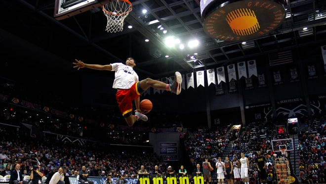 Joshua Reaves of Oak Hill Academy throws down a dunk during the first Tournament of Champions dunk contest at JQH Arena on Jan. 17.