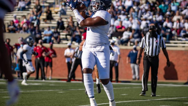 Georgia Southern tight end Beau Johnson makes one of his two touchdown catches against UMass on Saturday at Paulson Stadium in Statesboro.
