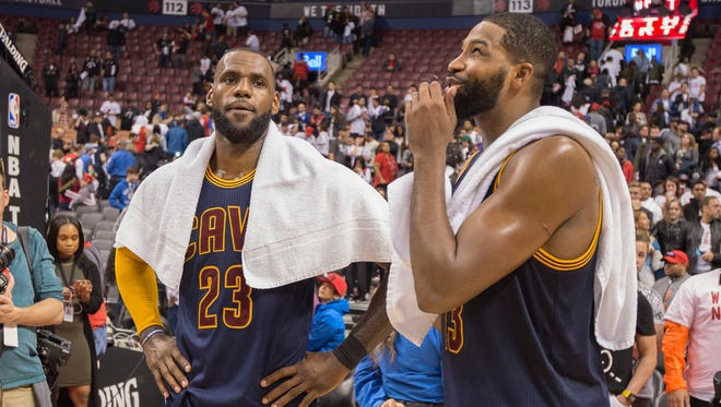 Cleveland Cavaliers forward LeBron James (23) and Cavaliers center Tristan Thompson (13) celebrate after the second round of game four of the 2017 NBA Playoffs against the Toronto Raptors at Air Canada Centre.