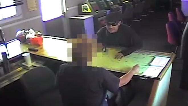 Surveillance video shows a robbery at the Rice Street Casino on Sunday.