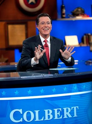"In this photo released by Comedy Central, host Stephen Colbert appears during the ""Been There: Won That: The Returnification of the American-Do Troopscapeon"" special of ""The Colbert Report,"" in New York. ""The Colbert Report"" will end on Thursday, after nine seasons."