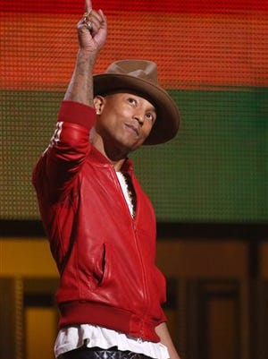 "This file photo shows Pharrell Williams on stage at the 56th annual Grammy Awards at Staples Center in Los Angeles.  Williams won four Grammys, including album and record of the year for producing the funk-electronic anthem ""Get Lucky."""